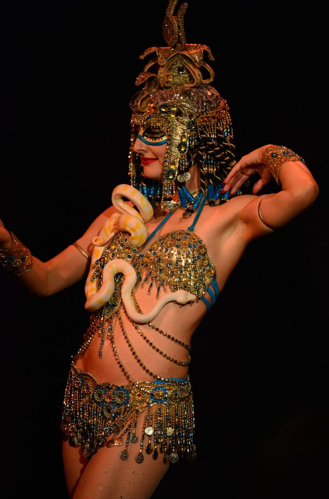"Egyptian Goddess Isis Serpent Dance with her golden python "" Golden Rubie's "" and this is the baby snake"